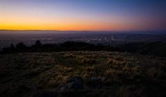 Christchurch Sunset (five15design) Tags: winter sunset sea newzealand christchurch sky evening canterbury hills citylights southisland tussock aotearoa canterburyplains canterburybight waimakarirriver