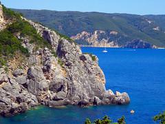 Paleokastritsa (Hanna Khoury) Tags: travel blue sea mountain green tourism water greece corfu grece ελλάδα kirkira palaiokastritsa يونان كورفو lonian