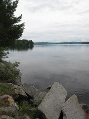 Stillness on the Lake (jchants) Tags: trees sky lake rocks newhampshire shore lakewentworth wolfeboronh