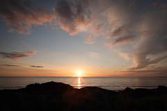 Sunset 9 - Hafnarfjrur (selmathk) Tags: ocean pink blue sunset red sea sky orange sun clouds iceland rocks horizon hafnarfjrur hafnarfjordur canoneos5d hvaleyri canonef25105mmf4lisusm pwpartlycloudy