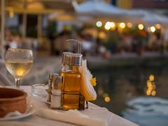 Sloping Table (Rupert Brun) Tags: island greek mediterranean wine harbour greece taverna tilt slope paxos arriva paxoi ionian lakka peloponnisosdytikielladakeio peloponnisosdytikielladakeionio