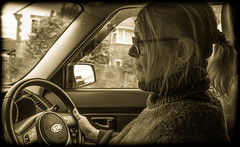 Driver. Kia Soul. (CWhatPhotos) Tags: inside omd em5 photographs photograph pics pictures pic picture image images foto fotos photography artistic cwhatphotos that have which with contain esystem four thirds digital camera lens taken prime art cabin kia soul car vechicle motorcar woman driving drive road driver sepia mlf flickr