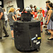 A robot wanders through the Maker Faire crowd.