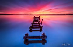 Gorokan (Kiall Frost) Tags: longexposure blue red sky orange lake colour water print artwork jetty australia canvas le nsw centralcoast gorokan kiallfrost