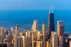 The Golden Sunset in Chicago (ManuelHurtado) Tags: city usa lake chicago building tower skyline architecture america skyscraper us illinois construction cityscape view unitedstates michigan places aerial midtown countries american estadosunidos