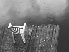 When it rains in Canada (Marie-Marthe Gagnon) Tags: wood bw texture water rain drops chair rainyday circles gray deck whitechair mpdquebec