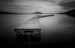 anchored (ArztG. Photo) Tags: monochrome austria chains quiet jetty earlymorning floating stillness attersee bounded earlystart leadin arztg photo