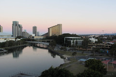 Watching the Sunset (Jocey K) Tags: trees sunset sky water architecture buildings reflections river evening crane australia queensland goldcoast broadbeach