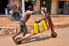Scooter Truck, Uganda (Rod Waddington) Tags: africa street boy truck work wooden scooter business worker uganda carry subsistence
