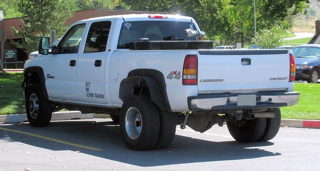 white chevrolet truck gm 4x4 diesel pickup pickuptruck turbo chevy ugly vehicle silverado gmc v8 madeinusa americanmade fourwheeldrive chev generalmotors 2000s heavyduty 1ton dually worktruck duramax 4door farmtruck crewcab turbodiesel generalmotorscorporation duramaxdiesel eyellgeteven