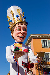 Nice Carnival 2014 (NykO18) Tags: people food man france male bird animal cake fruit person nice europe eagle hawk fork paca transportation pastry manmade raspberry vehicle nizza alpesmaritimes carnivalfloat carnavaldenice provencealpescôtedazur nicecarnival placemasséna kingofgastronomyfloat