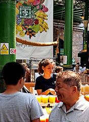 Fresh Juice Girl - Borough Market - Southwark (Olympus OMD EM5 & Panasonic - Leica 42mm Prime Lens) (markdbaynham) Tags: leica city uk people urban london lens four prime market candid capital evil olympus panasonic micro gb third borough metropolis asph southwark dg omd csc f12 m43 mft em5 u43 425mm micro43 m43rd u43rd nocticron
