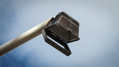 Flap-mouthed Floodlight (Theen ...) Tags: blue sky white black metal clouds mouth rust shot wind samsung adelaide flapping overhead floodlight loose theen