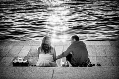 First Date - To Touch Or Not To Touch ? (Claus Tom) Tags: street sunset blackandwhite bw woman sun man male love female port copenhagen denmark evening harbor twilight marine couple sundown affection dusk candid space streetphotography attachment amour transportation passion devotion date cph emotions kbenhavn nightfall devoted fondness devotedness