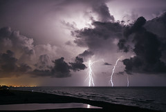 Inlet (lightonthewater) Tags: ocean storm reflection gulfofmexico thunderstorm lightning panamacitybeach seagrovebeach lightonthewater easternlake