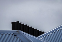 Confluence of Corrugations (Theen ...) Tags: winter sky black metal wall dark grey rooftops samsung stormy adelaide confluence angled corrugations finned theen corruatediron