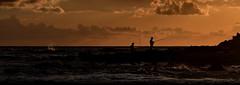 [ Huck, sono già ricco adesso, sono padrone di me stesso - Huck, I's rich now, I owns myself ] DSC_0395.2.jinkoll (jinkoll) Tags: sunset sea sky silhouette clouds fishing fisherman rocks waves peace vaticano capo calabria huckleberry