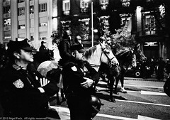 Europe's day of anti-austerity strikes and protests about to turn violent. (Pexpix) Tags: madrid blackandwhite bw horse film monochrome spain police demonstration ilfordhp5 es banners mammals journalism policia demonstrators policemen leica28mmsummicronmf2asph id111323c leicampsilver leica28mmsummicronmf2asphleica28mmsummicronmf2asphleica28mmsummicronmf2asph