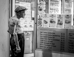 Hot and hungry (Salle-Ann) Tags: urban bw man tattoo menu blackwhite cafe streetphotography oldman cap barechest