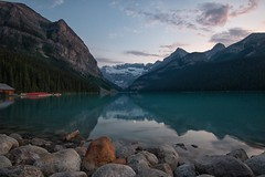 After the Crowds (dbushue) Tags: sunset moon canada mountains nature clouds reflections landscape evening nikon rocks peaceful calm glacier canoes alberta serene lakelouise boathouse tranquil banffnationalpark canadianrockies 2014 victoriaglacier coth supershot damniwishidtakenthat coth5