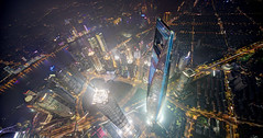 Soaring above (Tony Shi Photos) Tags: china city tower vertical skyline night skyscraper asia shanghai wideangle aerial fisheye financialdistrict  lookingdown   jinmao tallest eastasia birdeye  persepctive lujiazui swfc huangpuriver   shanghaitower highangleview