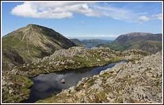 Lake in the sky. (stu.bloggs..Dont do Sundays) Tags: summer sky cloud lake mountains canon reflections landscape scenery rocks lakedistrict sunny haystacks fells views summit tarn lakeland crummockwater grasmoor highcrag 1555mm rockyoutcrops 1960ft