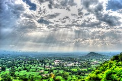 Sun beaming through Clouds implying to belive in hope against dark. (Manudev Bhardwaj) Tags: above sunset sun sunlight green clouds rays greenvalley sunrays greyshades abov