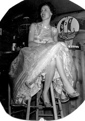 Petticoat Woman (kevin63) Tags: lightner vintagecheese facebook old antique vintage retro photo woman barstool sitting crossedlegs petticoat showing slip lace crinoline pumps fifties 50s blackandwhite photograph