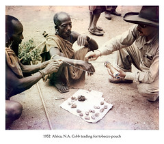 1952  Africa, N.A. Cobb trading for tobacco pouch (CORRECTED 400dpi 24-bit) (cobbbr) Tags: africa travel safari 1950s cobb caption corrected 1952 imagetypephoto imagesizeframe