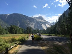 Biking Through Yosemite Valley (colonelchi) Tags: california road park street family trees shadow vacation sky cliff cloud mountain mountains tree apple grass car bike forest truck nationalpark afternoon ride meadow rail cliffs sierra smartphone national valley shade yosemite biking granite yosemitenationalpark sierras railing bikeride bluffs visitors sierranevada visitor rider range bluff yosemitevalley iphone mountainrange 5s bikerider iphone5s