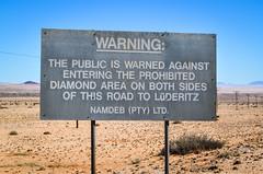 Warning against entering the Sperrgebiet, Namibia (jbdodane) Tags: b4 africa alamy140926 ausluderitzroad bicycle cycletouring cycling cyclotourisme day631 desert diamond g mining namibia road sign sperrgebiet velo warning karas freewheelycom alamy jbcyclingafrica