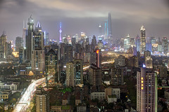 Shanghai, a vertical city (Tony Shi Photos) Tags: china city urban motion skyline modern night buildings movement skyscrapers shanghai traffic chinese citylife hilton nightlife  development jinmao futuristic urbanlandscape lujiazui swfc orientalpearltvtower  shanghaitower yananelevated