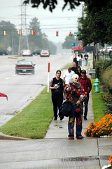 Don't follow a clown with bags. (kennethkonica) Tags: costumes people usa men cars rain america fun women midwest traffic indianapolis indy indiana horror conventions clowns damp hoosiers marioncounty maskfest horrorhound2014