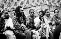 One Man, Ethiopia (Rod Waddington) Tags: africa people bw man dreadlocks one mono crowd group stick ethiopia shamma ethiopian walkng aigret tigray blackenedwhite