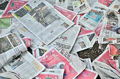 Discarded free newspapers on a pavement, London, UK (Roberto Herrett) Tags: uk greatbritain england colour london horizontal unitedkingdom britain pavement many newspapers free ground nobody several rubbish gb waste discarded coloured lots stockphoto wasteful numerous rherrettflk