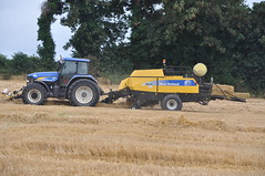 New Holland TM190 Tractor with a New Holland BB930A Big Baler (Shane Casey CK25) Tags: county new blue ireland horse irish tractor holland field yellow work golden big hp corn power cut farm cork farming grain working harvest straw nh till crop cutting land crops farmer blade agriculture dust bb pulling contractor chaff collect blades collecting baler 930 tilling harvesting cnh agri tillage tm190 castletownroche harvest2014 bb930a