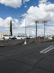 Active clouds, a variety of tall things, and a mildly elevated parking lot. (Tim Kiser) Tags: 2015 20151007 arizona arizonalandscape broadwayboulevard eastbroadwayboulevard highlandvistacincovia highlandvistacincovianeighborhood img7729 italiancypress mediterraneancypress october october2015 pimacounty pimacountyarizona target targetparkinglot tucson tucsonarizona tucsonlandscape asphaltconcrete asphaltconcreteparkinglot asphaltconcretepavement blacktop blacktopparkinglot bollards cars crackpatcher cumulus cumulusclouds cypress diagonalstripes distantbollards eastsideoftucson easterntucson electriclines electricpoles lampposts landscape lightpoles ornamentalcypress overheadelectriclines overheadpowerlines parkedcars parking parkinglot parkinglotlandscape partlysunny patchedcracks paved pavement powerlines retainingwall sealedasphalt sealedcracks sealedpavement southarizona southeastarizona southeasternarizona southernarizona stripedbollards stripes telephonepoles urbanlandscape utilitypoles view wall whitestripes unitedstates
