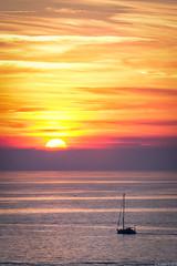 Sunset over the Adriatic Sea - 2 (Visualvalhalla) Tags: slovenia calm adriaticsea clouds orange balloffire piran boat seagull yellow sailboat sea