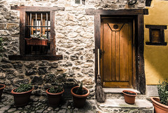 The witch is at home (Luis Marina) Tags: witch house door windows shadow stone facade architecture street potes cantabria 11mm nikon bruja escoba broom piedra puerta ventana fachada arquitectura calle pueblo sombra