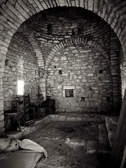 Into a Greek old monastery... (kallchar) Tags: monastery old building ruins ruined stoned stones chairs wood rubbish dust black white bw olympus omd 10 markii religion greek greece windows arch architecture blackandwhite flickr