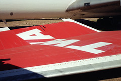 TWA 707 vertical stabilizer (Ian E. Abbott) Tags: aircraft jet boeing 500views 707 boneyard twa airliner boeing707 davismonthan amarc davismonthanafb jetairliner verticalstabilizer transworldairlines masdc lostwings amarg derelictaircraft aircraftstorage desertboneyard aircraftscrapping