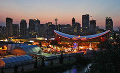 Downtown Calgary from Scotsman's Hill (LostMyHeadache: Absolutely Free *) Tags: city trees sunset shadow summer sky urban calgary water leaves night clouds canon buildings reflections river lights evening twilight saddledome downtown glow skyscrapers dusk silhouettes atmosphere ferriswheel rides grounds stampede bowriver highrises calgarytower calgarystampede davidsmith thebow calgaryalbertacanada eos60d