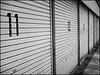 11   12   13 (David Panevin) Tags: street blackandwhite bw japan olympus storage numbers springs kochi omd urbanfragments em5 bokehlicious japaninbw kōchi leicadgsummilux25mmf14asph kōchishi