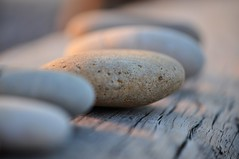 pebbles (emm 4) Tags: wood sunset beach nikon pebbles d90