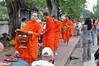 The monks walk by stone faced, and you are not allowed to talk to them either (shankar s.) Tags: southeastasia earlymorning buddhism tourists lp laos luangprabang buddhistmonk laopdr makingmerit unescoworldheritagecity buddhistreligion takbat buddhistfaith morningalmsgivingritualluangprabang morningalmsgivinginluangprabang
