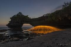 Steel wool at batubolong (Goesena) Tags: sunset sky bali cloud green water yellow rock landscape temple fire pura tanahlot steelwool batubolong