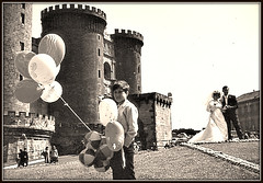 Waiting for the Guests - Balloon Seller, Napoli, 1977 (ronramstew) Tags: wedding italy castle couple italia campania balloon napoli naples vendor 1970s 1977 seller castelnuovo maschioangioino