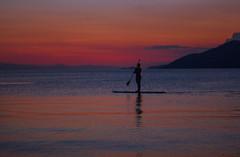 Paddle boarding under the twilight (Vagelis Pikoulas) Tags: sunset summer sky people sun mountain man mountains canon 50mm twilight kiss board paddle canoe end x4 2014