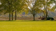harvest time (Nate Milo) Tags: trees tractor field landscape warm afternoon farm country harvest