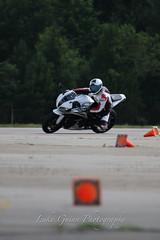 V51A1950 (lgphotoshare) Tags: race speed honda fun outdoor scooter triumph motorcycle sportbike wheelie stunts cbr shoei speedtriple kneedragging 7dmkii ef70200ismkii